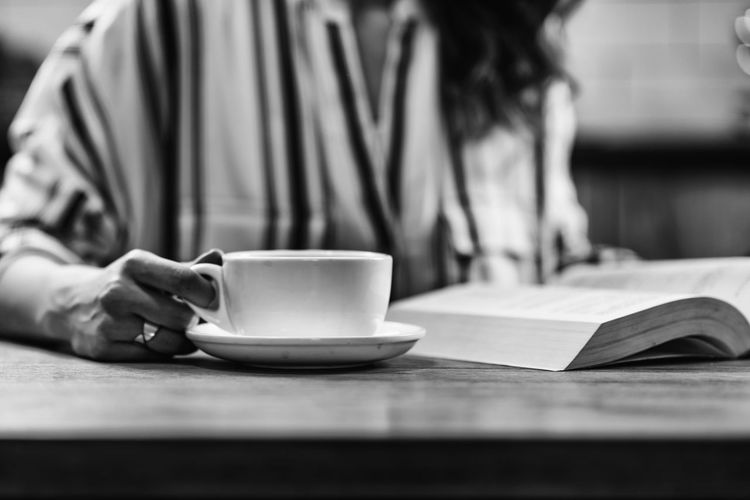Woman Drinking Coffee and Reading Book Coffee Female Kettle Woman Cafe Home Drink Girl Cup Hot Glass One Person Enjoy People Caucasian Happy Lifestyles Drinking Coffee Concept Caffeine Indoors  Holding Beautiful Adult Casual Break Table Aroma Close Up Drinking Happiness Coffee Cup Relaxation Coffee - Drink Book Indoors  Hand Mug Reading Book Black And White