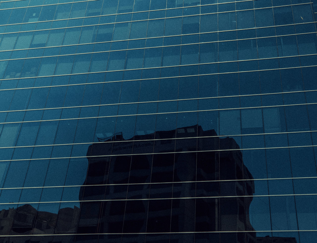 building exterior, built structure, architecture, glass - material, building, city, low angle view, reflection, modern, office building exterior, office, window, no people, sky, nature, outdoors, day, pattern, skyscraper, clear sky
