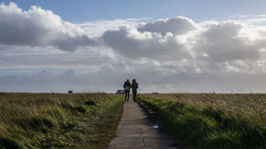 Beauty In Nature Cloud - Sky Day Direction Footpath Full Length Grass Land Leisure Activity Lifestyles Men Nature Outdoors People Plant Real People Rear View Scenics - Nature Sky The Way Forward Walking