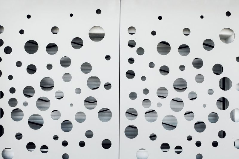 Close-up of holes in sheet metal