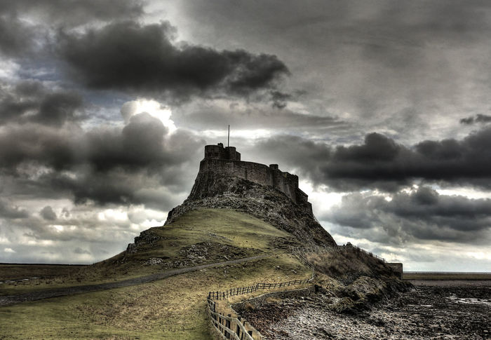 Castle on a hill Lindisfarne Castle Architecture Beauty In Nature Building Exterior Built Structure Cloud - Sky Day History Holy Island Castle Landscape Lighthouse Lindisfarne Nature No People Outdoors Sky Storm Cloud