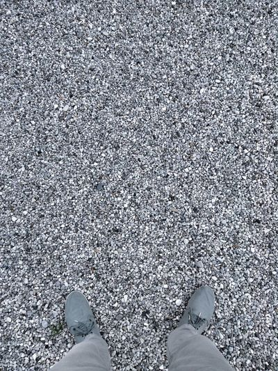 A lot Low Section Human Leg Shoe Real People Standing One Person Pattern Textured  Outdoors Close-up Gravel Stones Piedrecillas Shoes Trousers POV Background Texture Minimalism Day Lost No Color BIG Monotony Contrast The Week On EyeEm