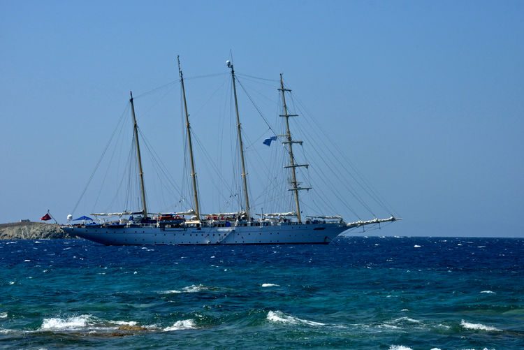 sailing ship sailing in a windy day in a sea in front of Mykonos Sea Nautical Vessel Sailboat Water Mode Of Transportation Transportation Sky Sailing Ship Sailing Ship Mast Blue Clear Sky Nature Travel Pole Horizon Horizon Over Water Day No People Outdoors Yacht Luxury Waves Seascape Mykonos,Greece Summertime Cruising Cruise Charter