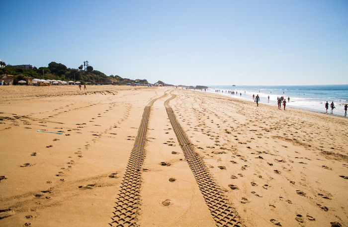Albufeira Algarve Areia Arena Beach Blue Sky Clear Sky Large Group Of People Mar Meer Nature Outdoors Pista Playa Portugal Praia Sand Sea Sky Spuren Strand Sunlight Track Vacations Let's Go. Together.