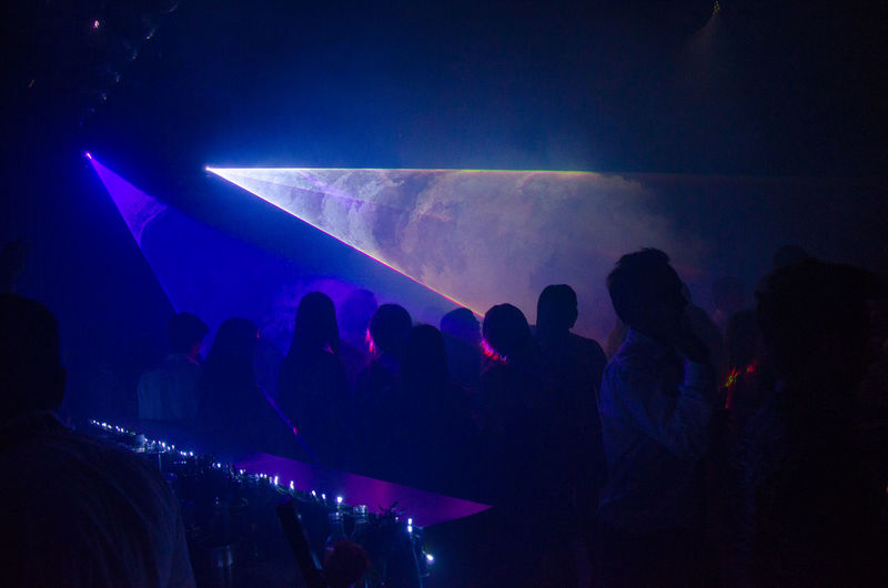 Light beams falling on people in nightclub