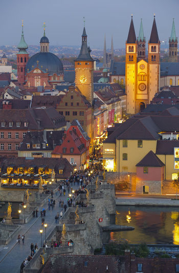 High angle view of illuminated buildings at dusk