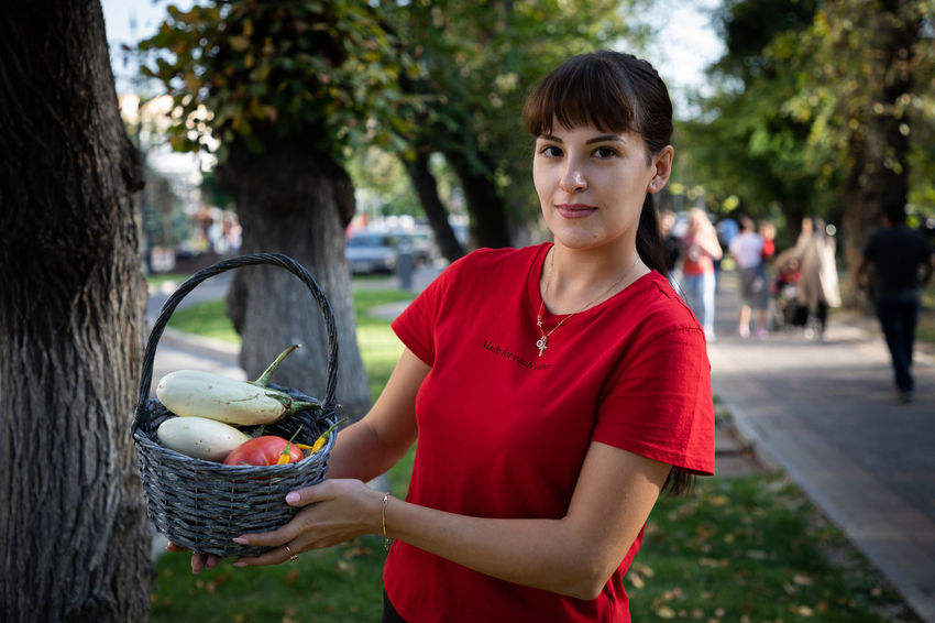 EyeEmSelect WeekOnEyeEm Basket Beautiful Woman Day Freshness Fruit Healthy Eating Lifestyles Looking At Camera One Person Outdoors Portrait Real People Red Young Women