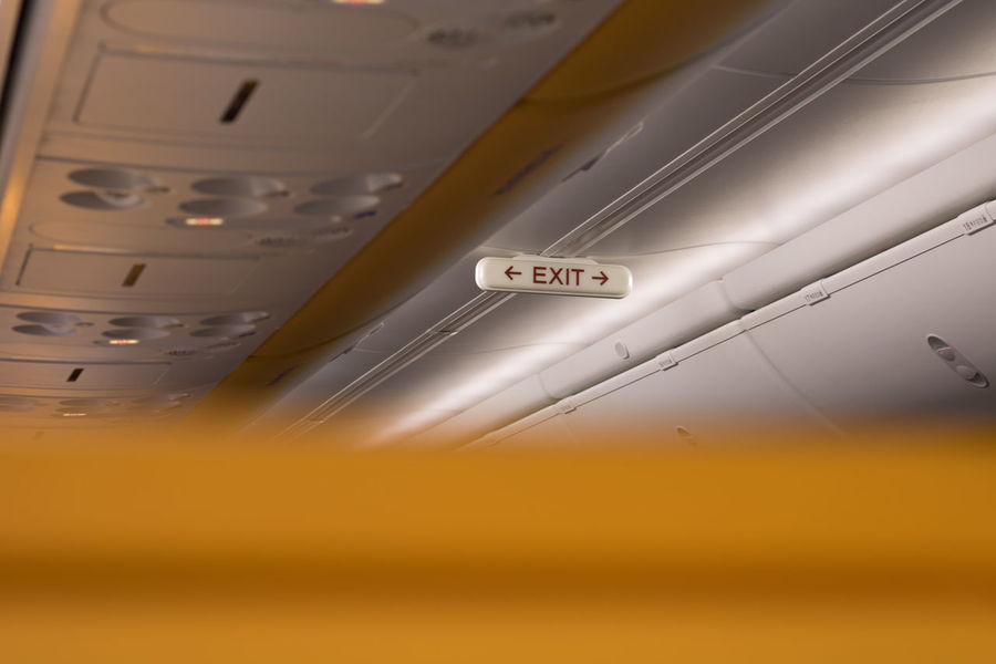Text Transportation Indoors  No People Day Emergency Exit Tourist Flight Plane Security Safety Landing Departure TakeOff Airplane Sign Exit Exit Sign Door Fasten Seat Belt Airport Indicate Text Flight Attendant No Edit/no Filter