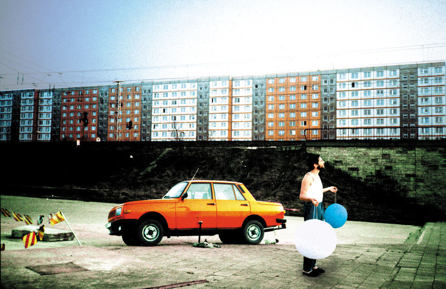 A Man And Wartburg A Man, Wartburg And Self Made Lamps Blockhaouses In East Berlin Mehr Licht! Mode Of Transport One Person Ost Berlin Sosialism Tristess Waiting For Buyers Wartburg