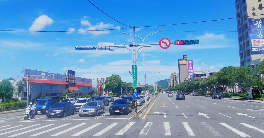It's a beautiful day, beautiful sky. Don't let it get away blue sky sky outdoors adventures in the city Sunny Summer In The City Blue Sky Sky Outdoors Taipei Taiwan City Road Sign Road Sky Building Exterior Road Signal Stop Sign Zebra Crossing City Street Road Marking Crossroad Traffic Light  Arrow Sign Warning Sign Green Light Red Light Information Crossing Sign