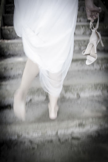 One Person White Color Barefoot People Shoe Wedding Dress Love Weddingday  Weddingshoot Wedding Photography Wedding Nature Running Bride Bride Bride Running Shoes Bride Shoes Bridegroom Human Foot Wedding Ceremony Pair Newlywed Adventures In The City