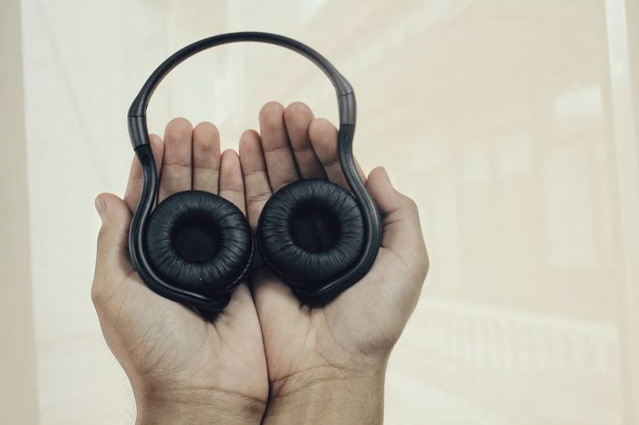 The OO Mission Headphones Technology I Can't Live Without Light Hands Clean Background Wireless Technology