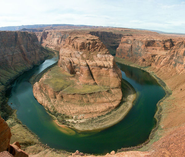 Scenic View Of Colorado River At Horseshoe Bend Against Sky