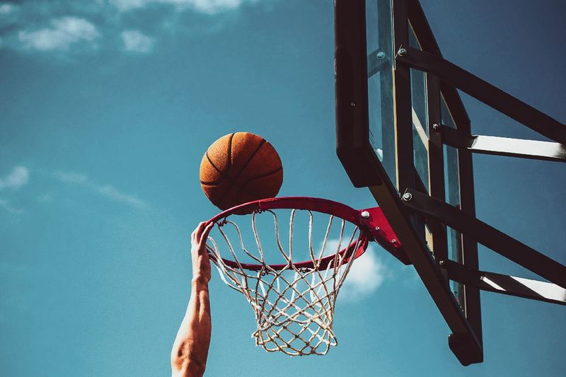 Basketball - Sport Basketball Hoop Sport Net - Sports Equipment Ball Basketball - Ball Sky Low Angle View Nature Day Taking A Shot - Sport Motion Leisure Activity Making A Basket Playing Outdoors Relaxation Team Sport No People Metal