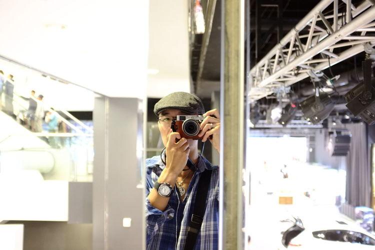 Man taking selfie in mirror reflection
