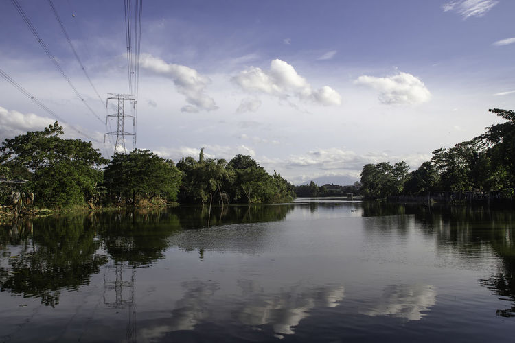 Water Sky Reflection Cloud - Sky Tree Nature Waterfront Plant Cable Electricity Pylon Tranquility Tranquil Scene Lake Electricity  Beauty In Nature No People Power Line  Connection Scenics - Nature Power Supply Reflection Lake