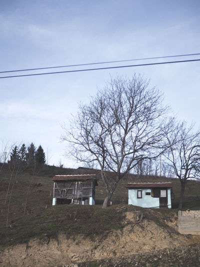 Rural Serbia Architecture Bare Tree Building Building Exterior Built Structure Cable Cloud - Sky Day Electricity  Europe Field House Land Landscape Low Angle View Nature No People Outdoors Plant Power Supply Residential District Sky Tree