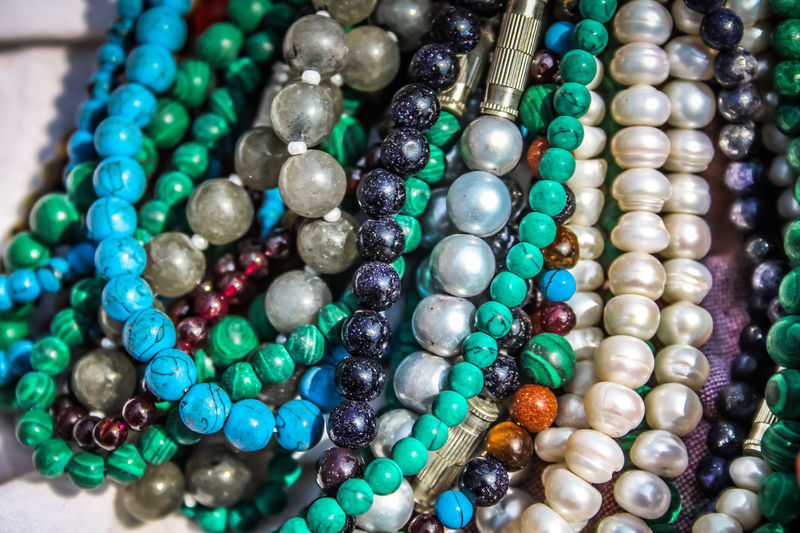 closeup of jewelry in India India Abundance Close-up Day Fashion For Sale Gemstone  Indoors  Jewelry Jewelry Store Large Group Of Objects Luxury Necklace No People Precious Gem Retail  Variation Wealth