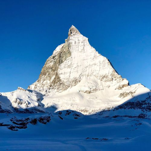 Good morning Matterhorn 🏔 Perfectday Visitswitzerland Bluewhite Ilovemountains Swiss Alps Switzerland Matterhorn  Zermatt Mountain Snow Nature Beauty In Nature Blue Scenics Snowcapped Mountain Winter Clear Sky