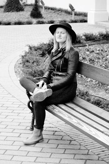 Smiling beautiful woman sitting on bench