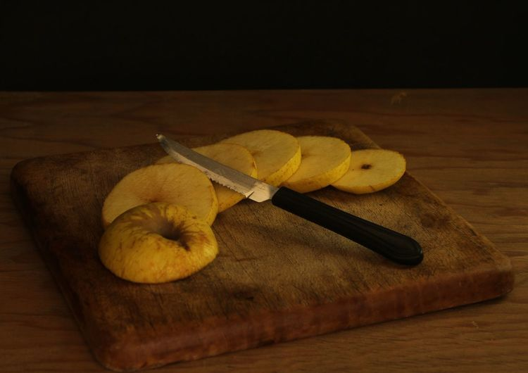 High angle view of banana on cutting board