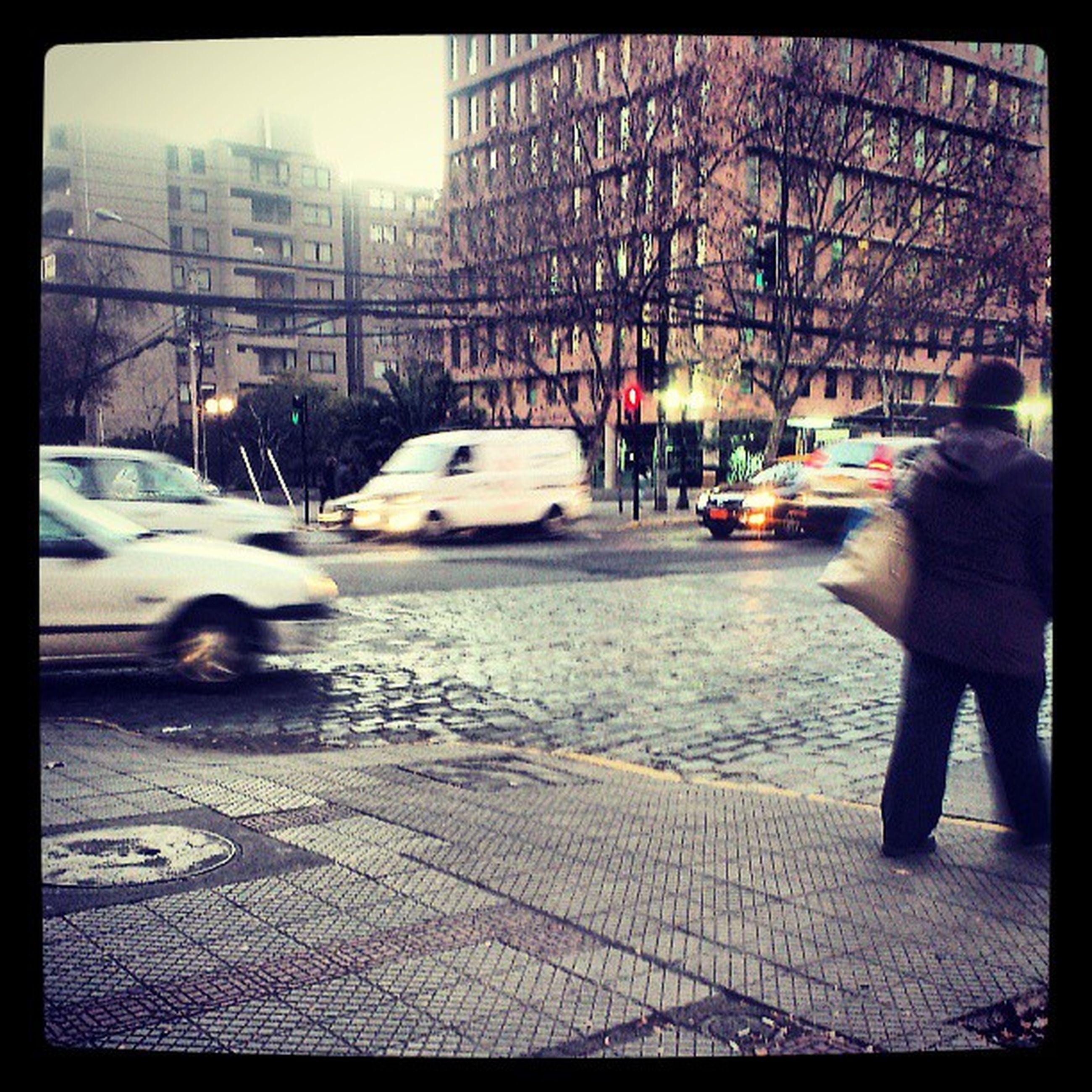 building exterior, transfer print, architecture, built structure, city, auto post production filter, street, lifestyles, city life, men, leisure activity, car, walking, person, unrecognizable person, season, winter, transportation