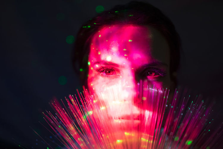 Portrait of man against illuminated light