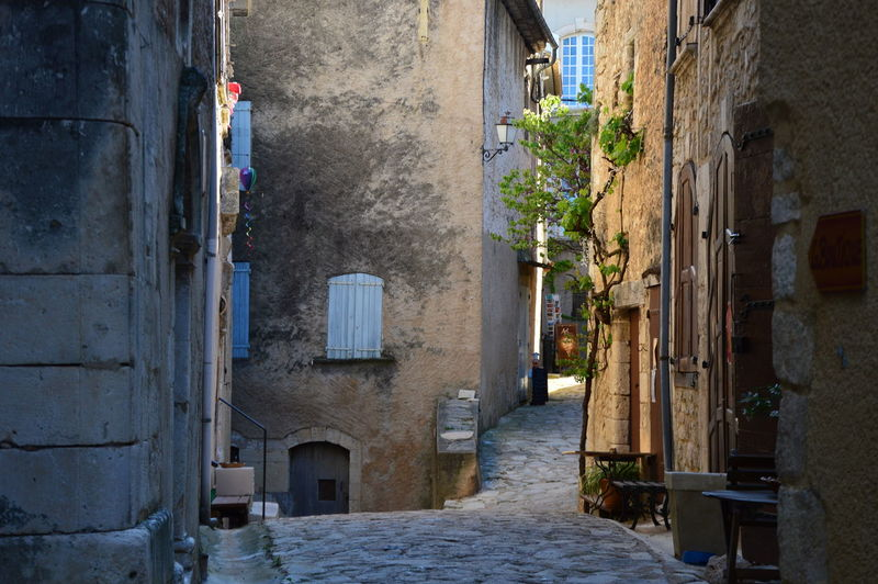 Typical french narrow street in a small village ,mediterranean Colors Doors Shutters Typical French Country Village Typical French Narrow Street In A Small Village Architecture Building Exterior Dark Passages France Streets House Narrow Narrow Street No People South Of France Street Streetphotography Town Typical French Village Village Life Village Photography Village View Windows Windows And Doors