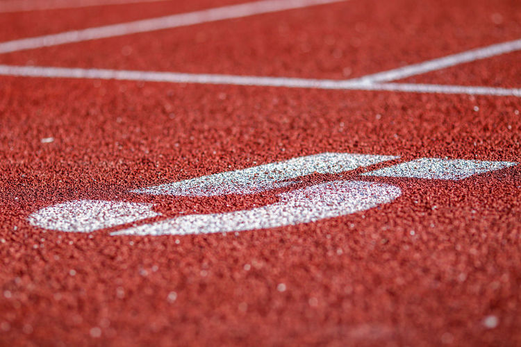 Close-up of number 5 on sports track