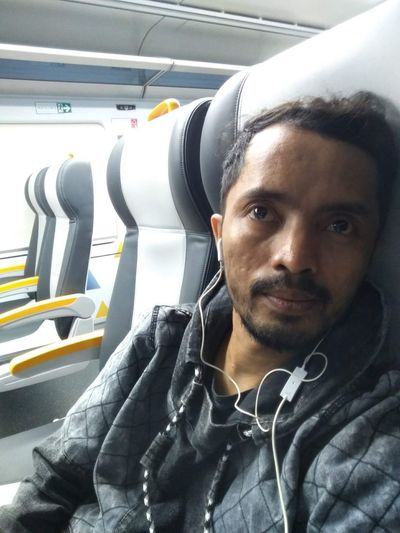 Portrait of young man in bus