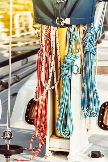 Sailboat Rope Sea Boat Ship Yacht White Nautical Sailing Yachting Rigging Travel Sport Transportation Vessel Outdoors Deck Detail Lines String Sunny Summer Toned Filtered Ocean Lifestyle Vacation Light Bight Bollard Cleat Dock Equipment Jetty Knot Recreational  Sunlight Tied Bundle Cord Loop Part Strength Tether Thick Twisted Pulley Pulling Wheel Winch