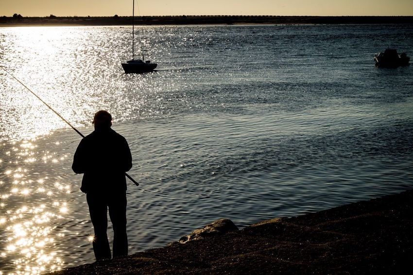Standing Sea Silhouette Water Full Length One Person Fishing One Man Only Tranquil Scene Tranquility Rear View Sunset Men Only Men Scenics Nature Beauty In Nature Outdoors Adult Horizon Over Water