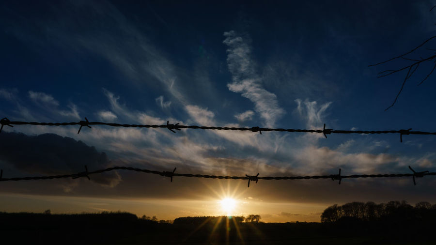 Sky Cloud - Sky Sunset Silhouette Beauty In Nature Nature Tranquility No People Tranquil Scene Sun Scenics - Nature Sunlight Fence Protection Safety Outdoors Security Landscape Cable Barbed Wire Electricity  Power Supply EyeEm Best Shots EyeEm Selects EyeEm Gallery