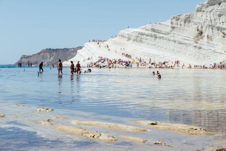 Tourists enjoying beach