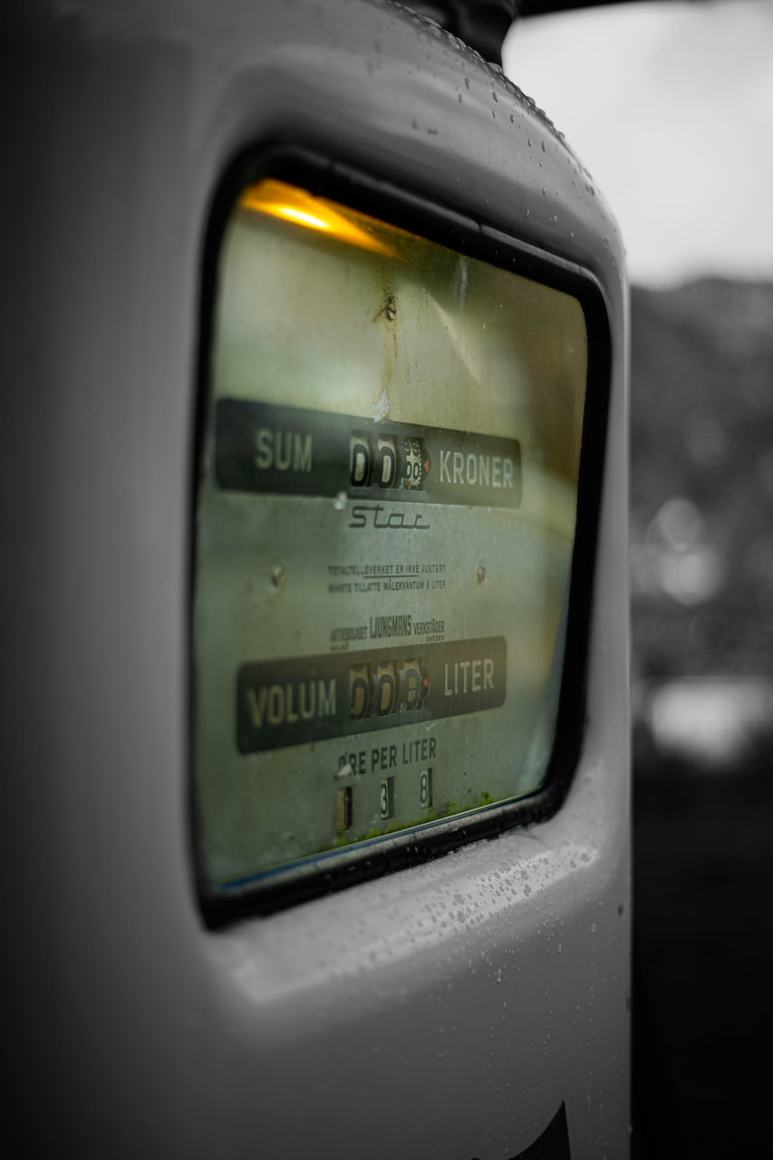 CLOSE-UP OF INFORMATION SIGN ON CAR