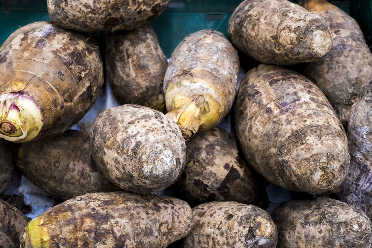 isolated Fresh harvested Satoimo potatoes. taro root. A plant that utilizes the root. Healthy Eating Freshness Organic Diet Delicious Nutrition Vegetable Ingredient Vegetarian Raw Food Sweet Closeup Natural Plant Object Nobody Group Assorted Sweets Tasty Cooking Cuisine Health Material Salad Gourmet Eating Vitamin Root Isolated Isolated White Background Food And Drink Agriculture Cultivated Nature Harvested Traditional Market Red Pile Crop  Nutritious Whole Vitamins Satoimo Potatoes Taro Root