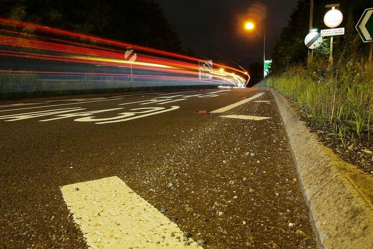 Illuminated Light Trails On Street In City