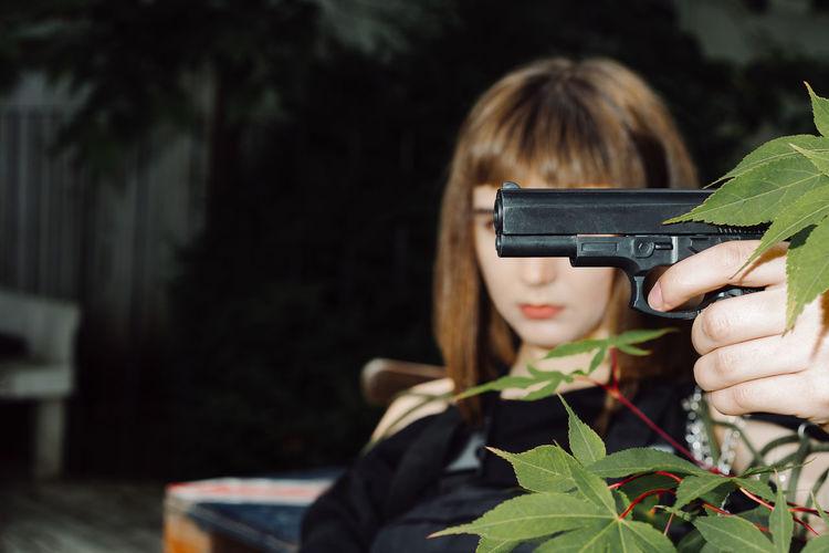Serious woman holding gun
