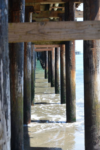 Architecture Beach Built Structure Day Nature No People Ocean Outdoors Pier Sea Sea And Sky Under A Pier Underneath Water Wood - Material