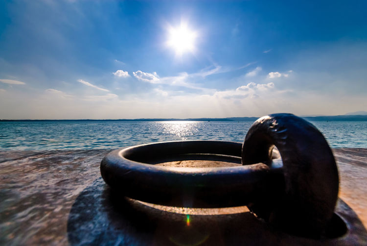 The docking ring Beauty In Nature Blue Blue Sky Close-up Day Docking Garda Horizon Over Water Jetty Lake Nature No People Outdoors Pier Rust Scenics Simple Sky Sun Sunlight Sunny Sunshine Tranquility Warm Water