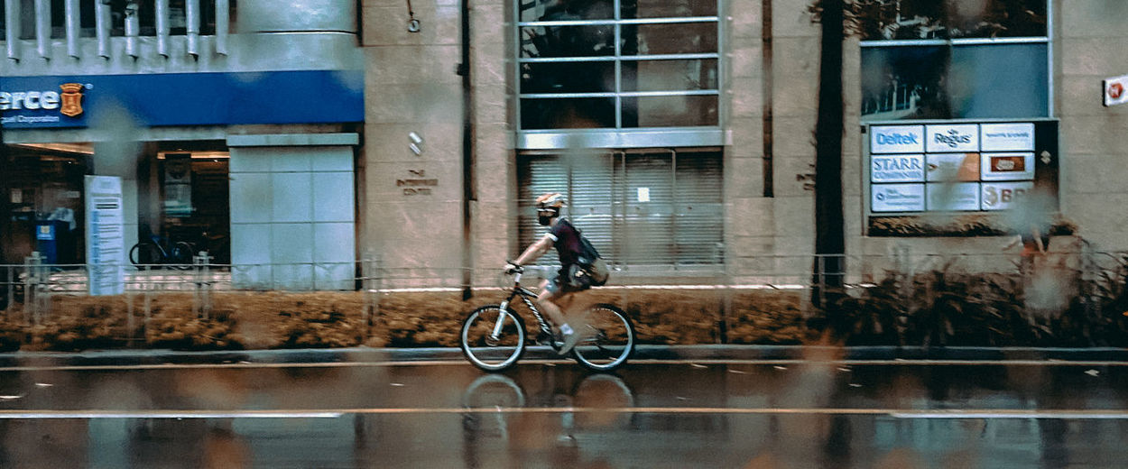 Man riding bicycle on glass window