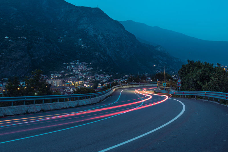 Light trails on highway road susa valley italy at night