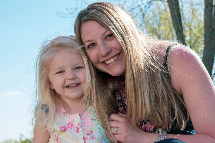 Portrait of smiling mother with cute daughter