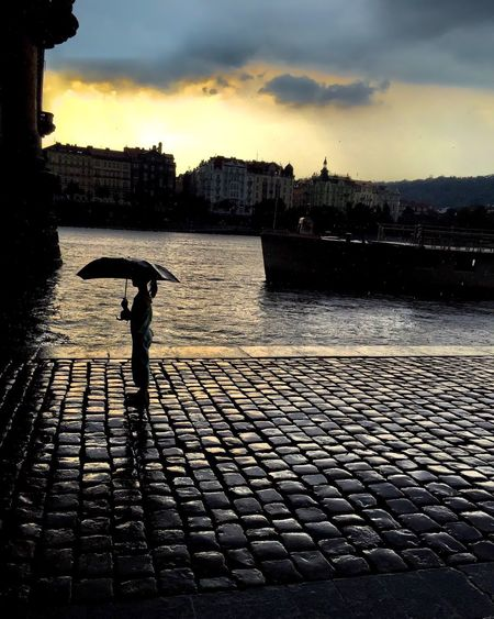 Czech Republic Prague River Riverside Naplavka City City Life Girl Child Children Rain Umbrella Boat Sky Clouds And Sky