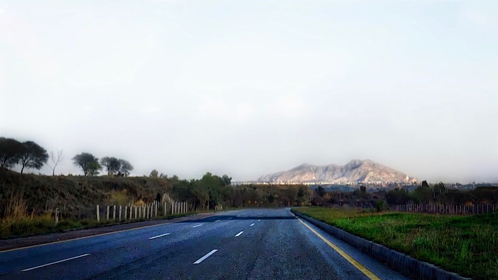 Amazing Pakistan Diminishing Perspective Empty Road Grass Hill Landscape Motorway Nature Road Road Marking Scenics Sky The Way Forward Tranquility Vanishing Point