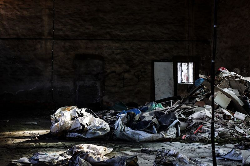 Abandoned garbage by building