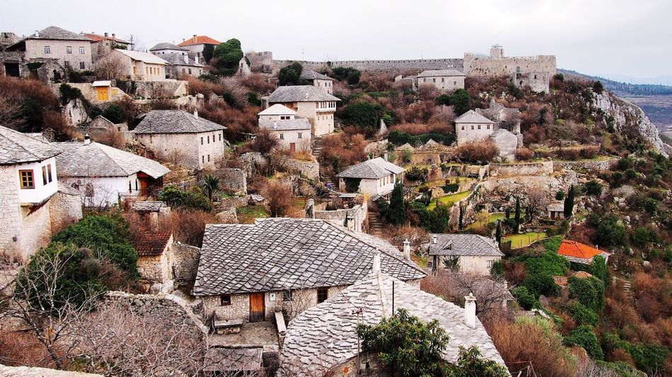 A village on a hill. Architecture Building Exterior Built Structure House Day No People Outdoors Cityscape Hill Sky Nature Town Residential Building Tree Roof Community Colour Your Horizn