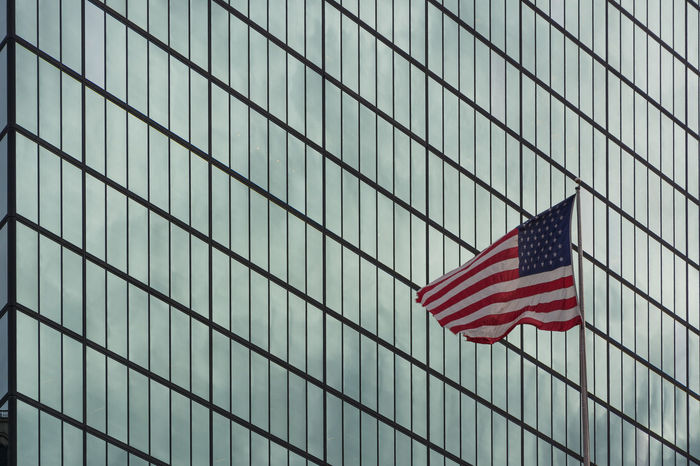 Battle Of The Cities New York City Flags In The Wind  Full Frame Geometry Glass Glass - Material In A Row Office Building Pattern Pattern Pieces Repetition Symbol Transparent USA FLAG Window The Architect - 2016 EyeEm Awards Flag Patriotism Low Angle View Flag Pole Freedom Building Exterior Architecture Stars And Stripes Striped #urbanana: The Urban Playground