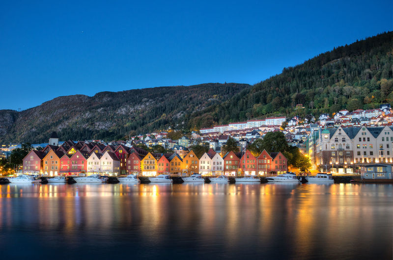 Architecture Beauty In Nature Bergen Blue Bryggen Built Structure Day Hill Mountain Mountain Range Nature No People Norway Outdoors Reflection Residential Structure River Scenics Sky Town Tranquil Scene Tranquility Travel Water Waterfront