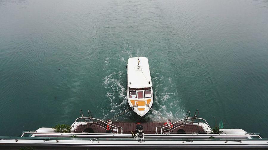 High angle view of ship sailing on sea